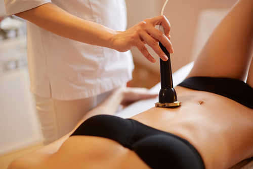 woman getting body contouring treatment on her belly